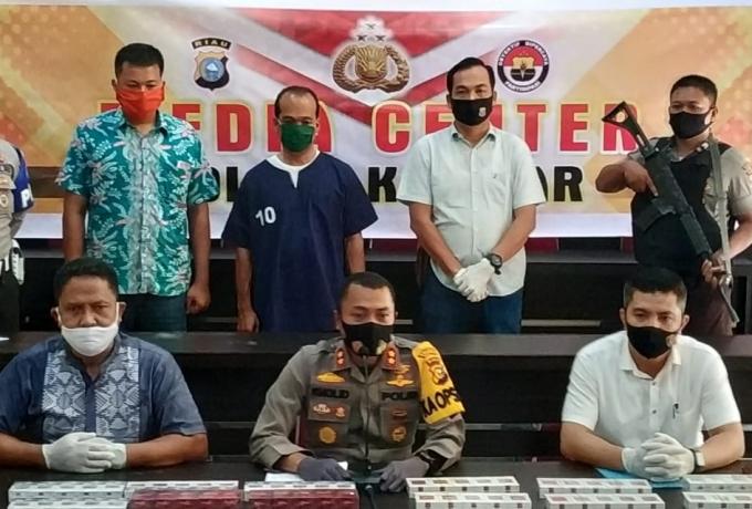 Polres Kampar Tangkap Tersangka Kepemilikan dan Peredaran Rokok illegal Tanpa Cukai