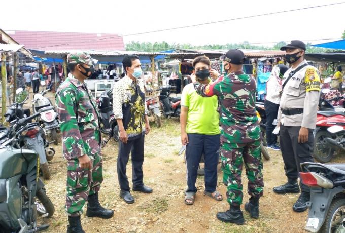 TNI POLRI Bersinergi Membagikan Masker Gratis dan Sosialisasi Protokol Covid 19