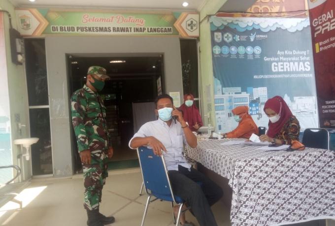 Babinsa Koramil 09/Langgam Monitoring Penerapan Prokes P Pelaksanaan Vaksinasi Covid-19